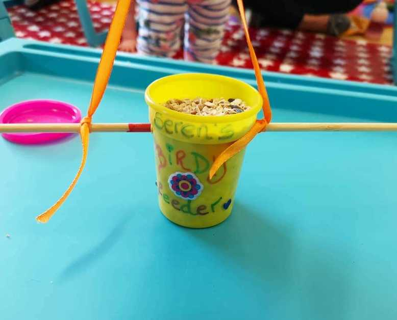 Recycled Play-Doh pots make awesome bird feeders!