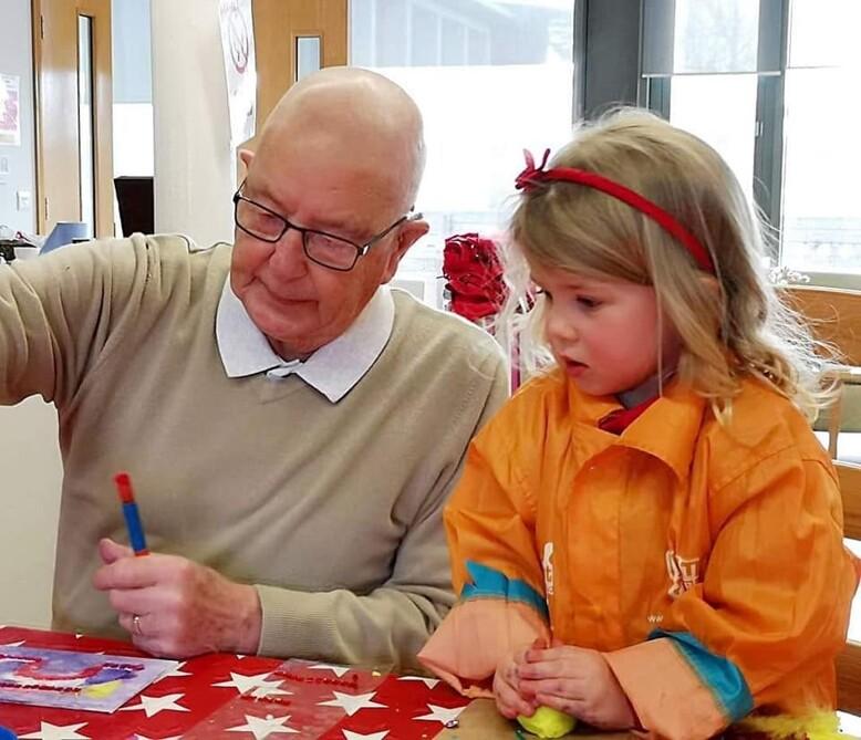 Creation Station Intergenerational fun granddad and girl having fun